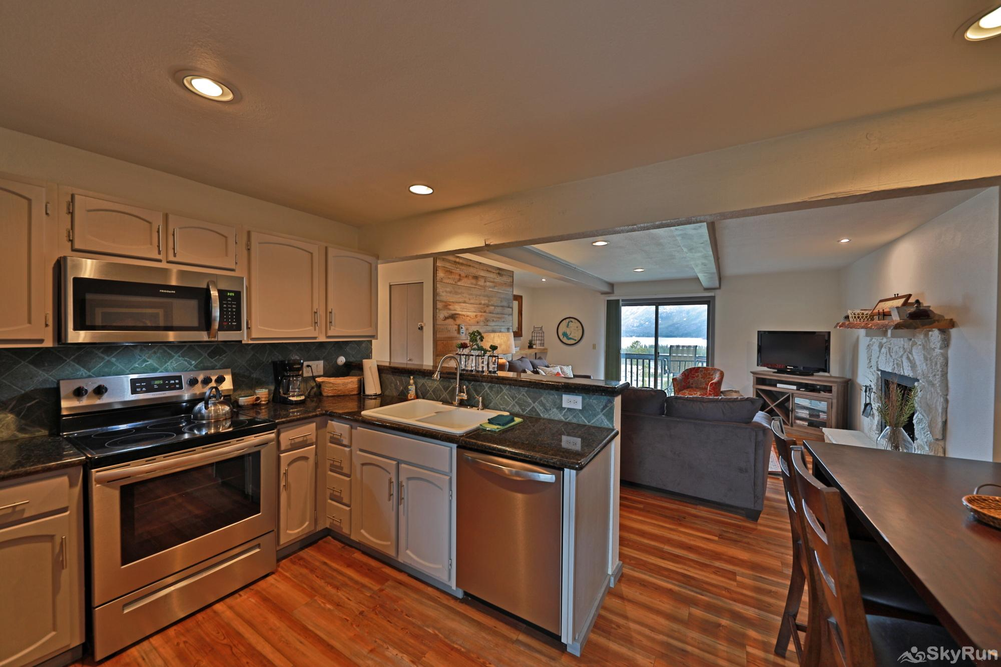 The Birdhouse at Shadow Park West Fully equipt kitchen with granite countertops and high end appliances
